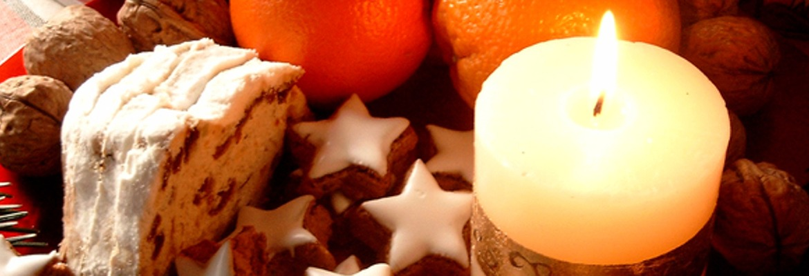 Candle, cakes, cookies and an orange